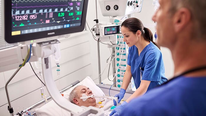 Nurse with critically acute intubated patient