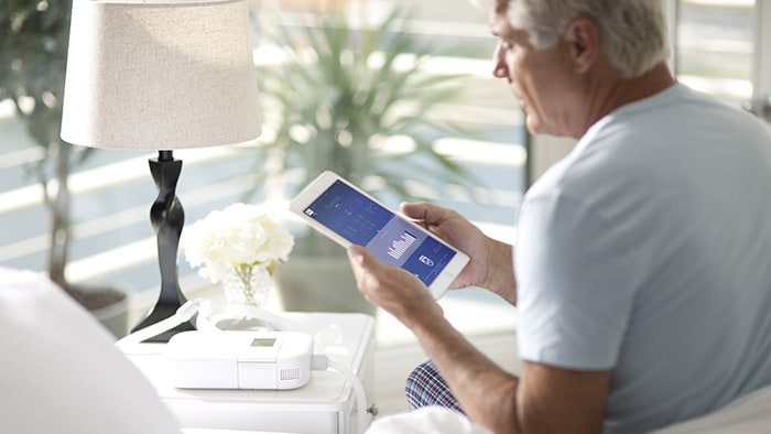 Philips CPAP man holding tablet