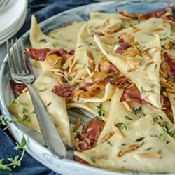 Leek and Potato Ravioli with a Creamy Thyme, Almond and Pancetta Sauce